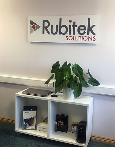 An internal wall sign for Rubitek Solutions