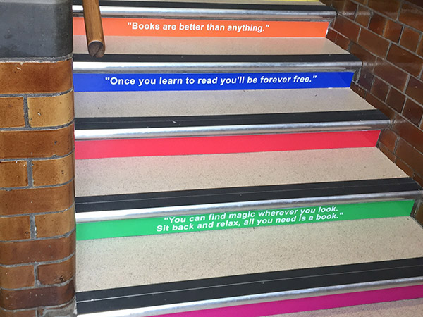 School stair graphics featuring quotes