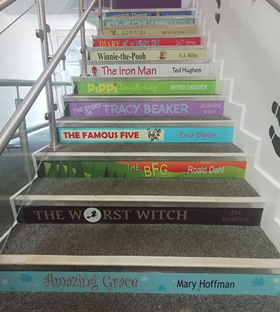 Book spine stair graphic for schools LKS2