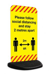 Pavement stand signs with Coronavirus Covid-19 social distancing design