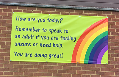 PVC banner for a Primary School asking pupils if they are ok during the Coronavirus Covid 19 times