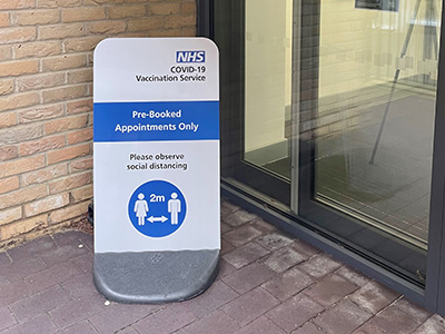 NHS South East London CCG vaccination centre services pavement sign