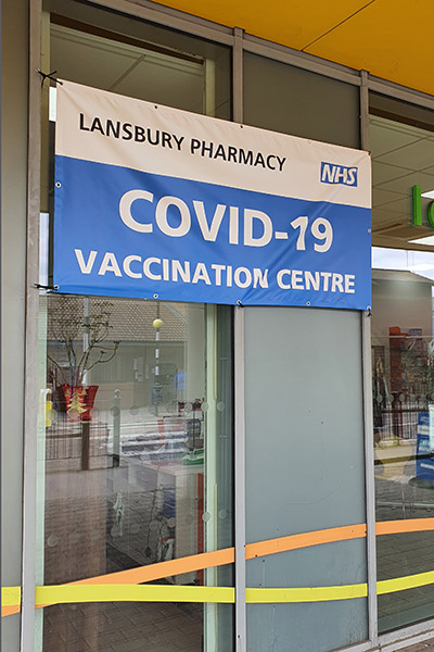 Covid-19 Vaccination Centre signage PVC banner displayed at a Pharmacy
