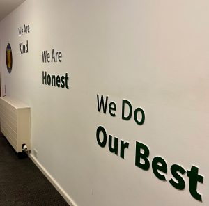Cut lettering Values signage on a school wall