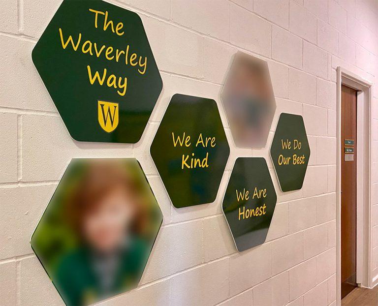 Hexagonal shape Values signage on a school wall