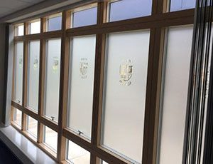 Frosted vinyl on windows in school corridor