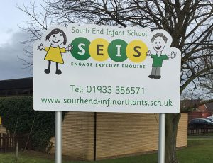 School post sign with shaped top