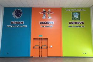 School values signage on hall walls
